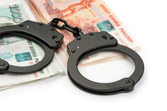 Handcuffs on Russian money Royalty Free Stock Photo