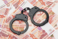 Handcuffs on Russian money Stock Photos