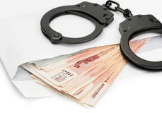 Handcuffs on Russian money Royalty Free Stock Photos