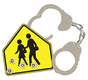 Handcuffs and school Stock Photo