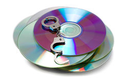 Handcuffs on stack of Cd Stock Image