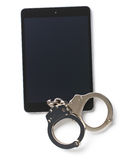 Handcuffs and tablet Royalty Free Stock Image