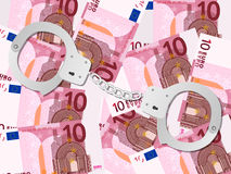 Handcuffs on ten euro background Royalty Free Stock Photography