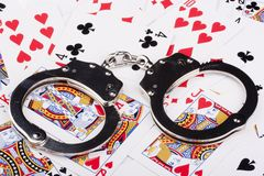 Handcuffs with things gaming Royalty Free Stock Photos