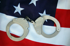 Handcuffs and USA flag Royalty Free Stock Photography