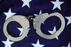 Handcuffs and USA flag Stock Image