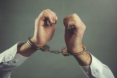 Handcuffs van de mensenhand royalty-vrije stock afbeelding