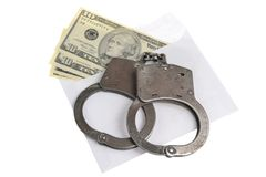 Handcuffs and white envelope with money on white background. Handcuffs and white envelope with money isolated Stock Photo