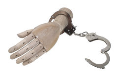 Handcuffs on a Wooden Hand Stock Photography