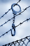 Handcuffss and  fence Royalty Free Stock Photo