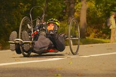 Handcycle on roadway Stock Images