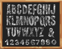 Handdrawn Font. Alphabet and Numbers with Grunge Lines and Strokes. Vector Scribble design. Isolated On  School Desk Background Royalty Free Stock Photography