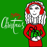 Handdrawn girl with headphones holding a gift box. Christmas lettering Royalty Free Stock Photos