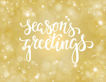 Handdrawn lettering season`s greetings. design for holiday greeting cards and invitations Royalty Free Stock Images
