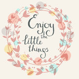 Handdrawn vector card.  Enjoy the little things. Handwritten tex. T, leaves flowers. Round herbal wreath, floral frame. Spring colors. White background Stock Photo