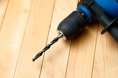Handdrill. On the wooden background Royalty Free Stock Images