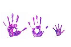 Handdrucke seines Vaters, Mutter und Kindes. Lizenzfreie Stockbilder