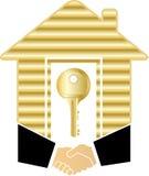 Handdruk met gouden huis en sleutel Royalty-vrije Stock Foto