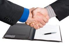 Handdruk over document en pen Royalty-vrije Stock Afbeeldingen
