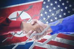 Handdruk tussen de vlag van Noord-Korea en van de V.S. Stock Afbeeldingen