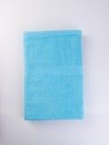 handduk eller badlakan på en bakgrund Royaltyfri Foto