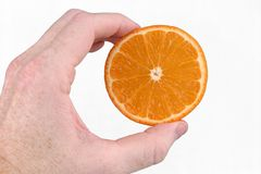 Handed Orange Royalty Free Stock Images