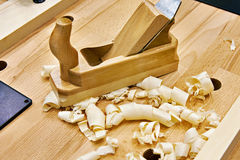 Handed planer on carpentry table and shavings. Handed planer on carpentry table and wood shavings Royalty Free Stock Images