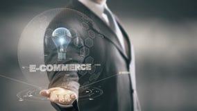 Handel elektroniczny z żarówka holograma biznesmena pojęciem zbiory