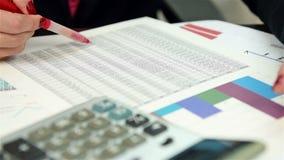 Handelaar Checking Financial Report stock video