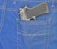 Handeldvapen i jeansfack Royaltyfri Fotografi