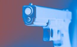 handeldvapen Kaliber 45 i rött, vitt, blått Arkivfoto
