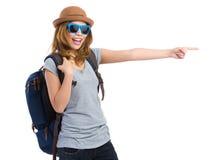 Handelsresande för ung kvinna med fingerpunkt åt sidan för riktning Arkivfoto