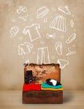 Handelsresandebagage med hand drog kläder och symboler Fotografering för Bildbyråer