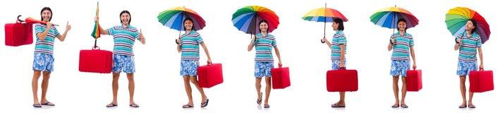 Handelsresanden med det röda fallet och paraply som isoleras på vit Arkivfoto