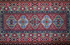 Handemade slavisk matta arkivfoton