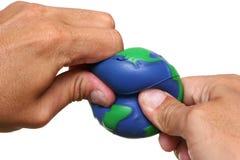 Handen die Aarde drukken Royalty-vrije Stock Afbeelding
