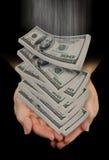 Handen die dalende dollars vangen Stock Foto