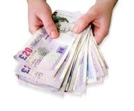 Handen die geld houden Stock Afbeeldingen