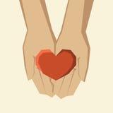 Handen die hart houden Stock Foto's