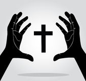 Handen die het kruis houden Stock Afbeelding