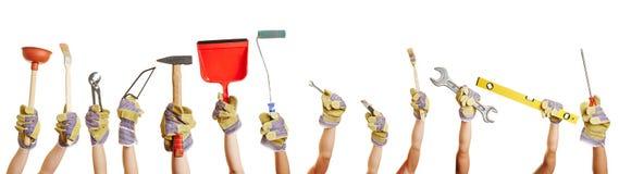 Handen die hulpmiddelen om te werken houden Stock Fotografie