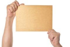 Handen die leeg document houden Stock Foto's