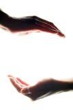 Handen die om het even wat houden Stock Foto