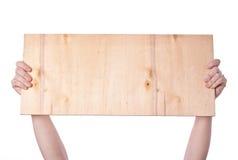 Handen die plank houden Stock Foto