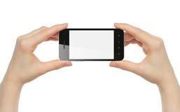 Handen die slimme telefoon houden Stock Afbeeldingen