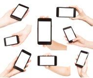Handen die slimme telefoons geïsoleerd houden Royalty-vrije Stock Foto