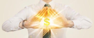 Handen die tot een vorm met dollarteken leiden Stock Foto