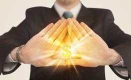Handen die tot een vorm met dollarteken leiden Stock Afbeeldingen