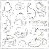 Handen drog klottret skissar illustrationuppsättningen av påsar - bagage för lopp, resväskan, fallet, handväska, Royaltyfria Bilder