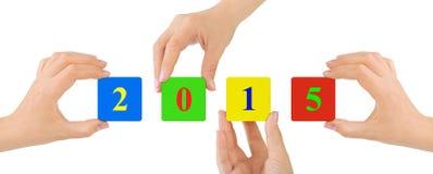 Handen en 2015 stock afbeelding